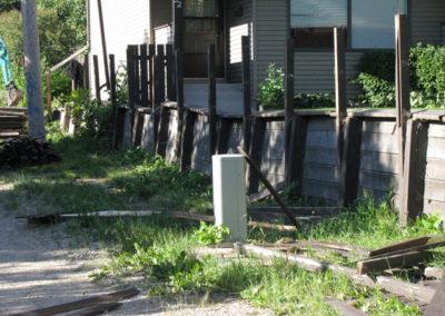 fence broken side of house property restoration calgary