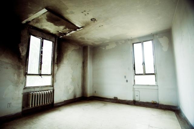 black walls from mold asbestos damage surrounding windows walls