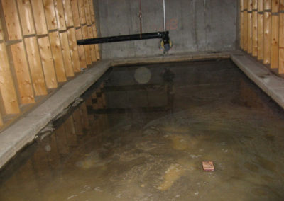 basement floor flooded water damage calgary