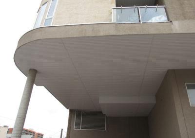 exterior support beam below balcony condo building