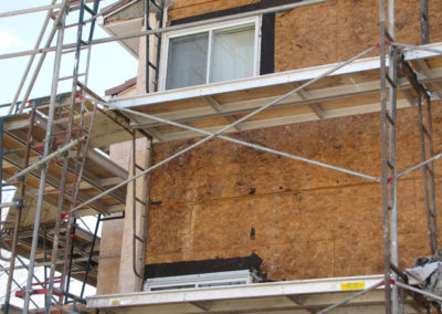 siding stucco repaired on building envelope calgary