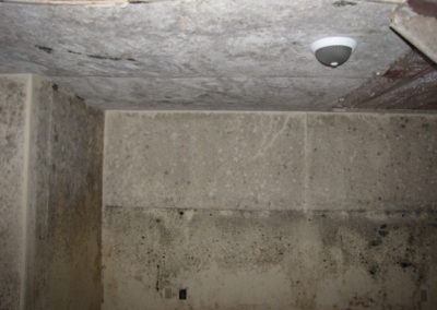 collapsed basement ceiling water and mold damage to cement wall