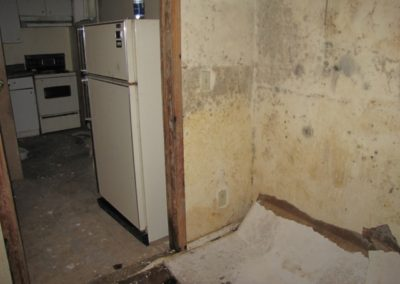 mold asbestos damage exposed kitchen walls