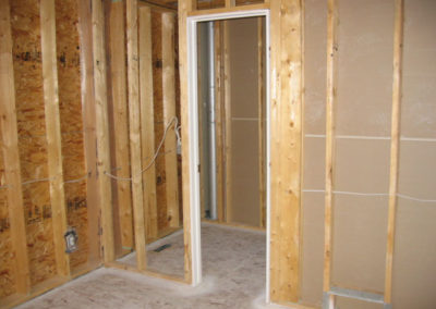 framed walls with open door frame being constructed