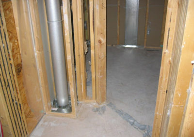 construction in basement drywalling wall frames exposed