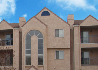 multiunit dwelling stucco and windows restored on building envelope